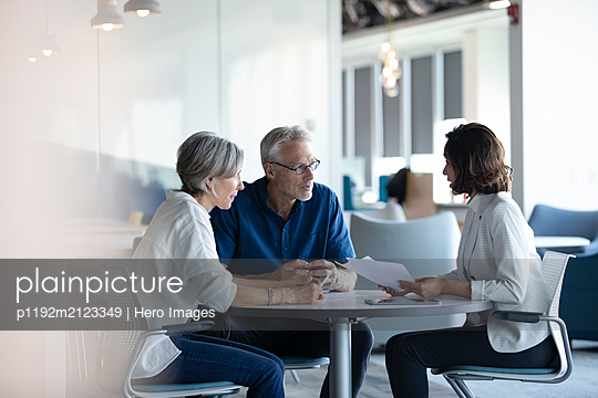 Senior clients discussing with financial advisor - p1192m2123349 by Hero Images