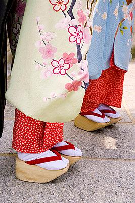 Maiko women wearing Japanese Kimono and Okobo (tall wooden shoes) - p6510533 by Gavin Hellier