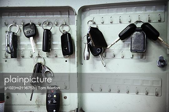 Keys on hooks in auto repair shop - p1023m2196753 by Tom Merton