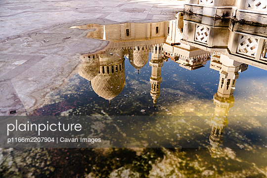 Reflection of A Mosque in a Puddle in Alexandria, Egypt - p1166m2207904 by Cavan Images
