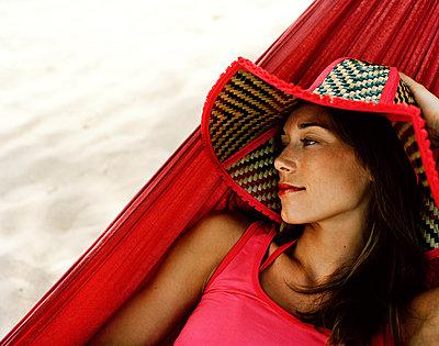 A Scandinavian woman resting in a hammock Thailand - p312m1076711f by Nicho Sodling