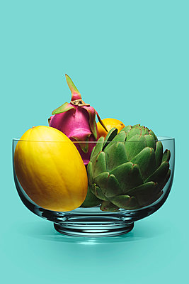 Crystal Bowl Filled with Artichoke, Melon, Dragon Fruit and Lemon - p694m2031438 by Novo Images