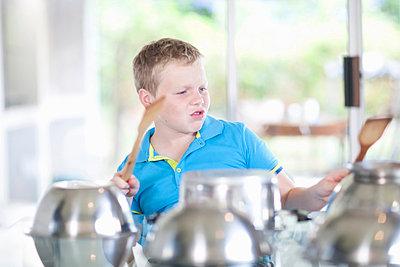 Boy pretending to be drummer - p924m805715f by Zero Creatives