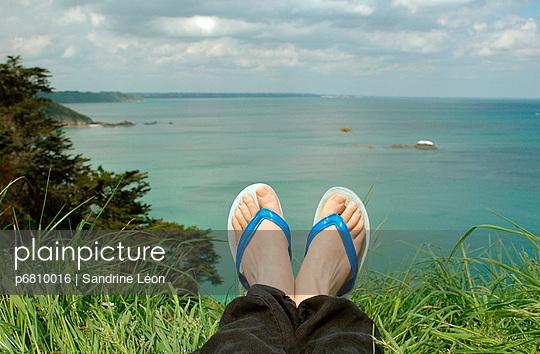 Feet and flip flops - p6810016 by Sandrine Léon