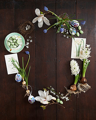 Easter Egg shaped floral still  life with Magnolia blossom  muscari and hyacinths and easter eggs and nests - p349m2167875 by Sussie Bell