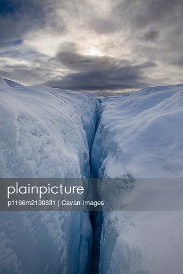 Blue ice crevasses on snowy glacier - p1166m2130831 by Cavan Images