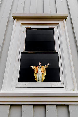 Figure of Jesus in a window - p1280m1161911 by Dave Wall
