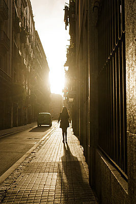 Pedestrian on sidewalk against the light, Barcelona - p1402m2217591 by Jerome Paressant