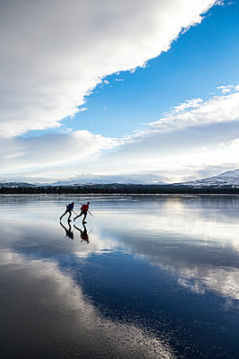 Two people moving on ice - p312m1113653f by Henrik Trygg