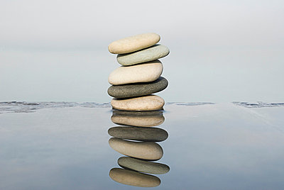 Stack of pebbles and water - p9248454f by Image Source