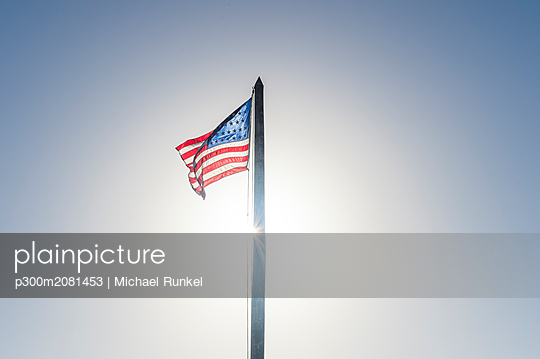 USA, Florida, Key West, American flag at backlight - p300m2081453 by Michael Runkel