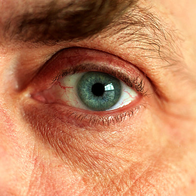 Extreme close-up portrait of a man with blue eye - p1025m788545f by Matton