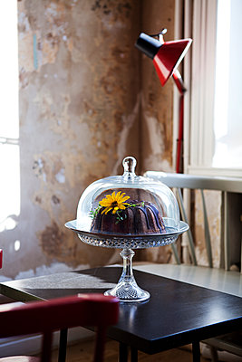Chocolate cake on table - p352m1100362f by John Sandlund
