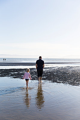 Father and son take a walk at the beach - p756m1461756 by Bénédicte Lassalle