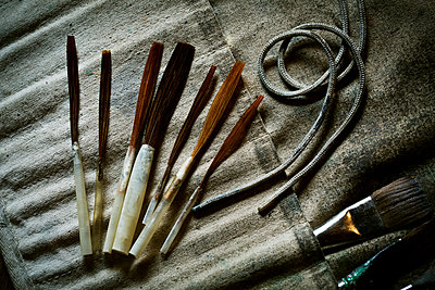 A collection of brushes and hand tools.  - p1100m1158328 by Mint Images