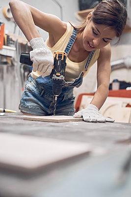 Woman in wood workshop - p1630m2196887 by Sergey Mironov