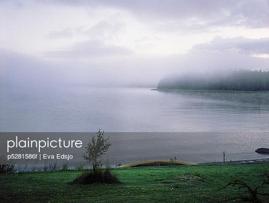 A hazy lake Sweden - p5281586f by Eva Edsjo