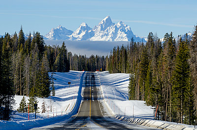 US Highway 287 and mountains in the winter.  Jackson Hole, Wyoming. - p1424m1501636 by Dan Ballard