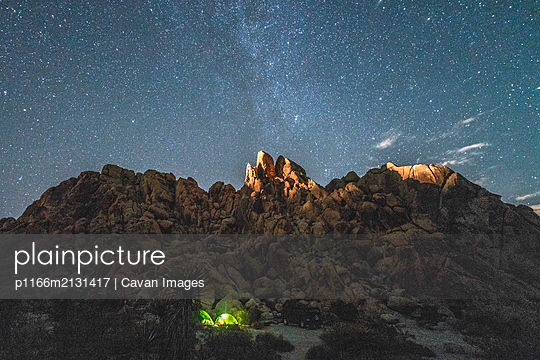 Camping in Mojave Boulder Garden Under Stars - p1166m2131417 by Cavan Images