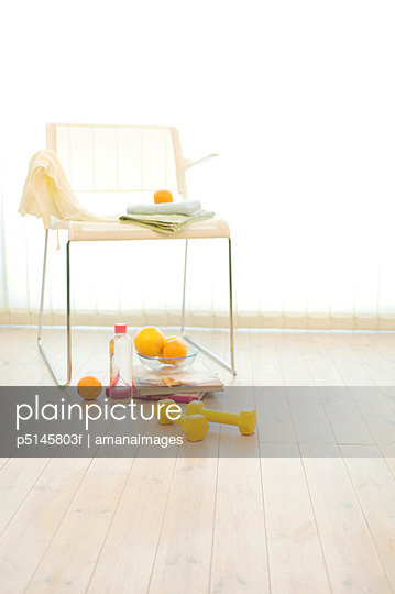 Dumbbell, chair, fruit and water bottle