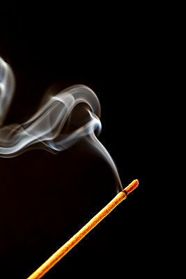 Smoke from an incense stick in front of a black background - p1302m2196156 by Richard Nixon