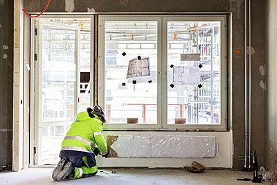 Builder at work - p312m1187713 by Susanne Kronholm
