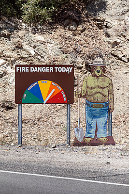 Fire danger warning sign on roadside at Santa Rosa Wilderness - p1094m1209113 by Patrick Strattner