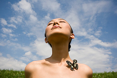 Woman with butterfly - p5350024 by Michelle Gibson