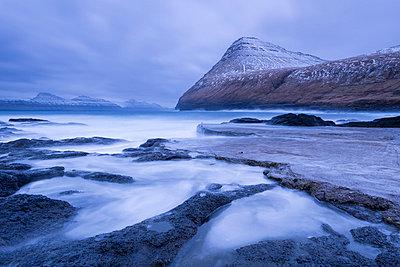 Dramatic coastline of Gjogv in winter on the island of Eysturoy, Faroe Islands, Denmark, Europe - p871m1048036 by Adam Burton