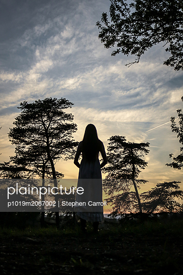 Young woman in the dusk - p1019m2087002 by Stephen Carroll