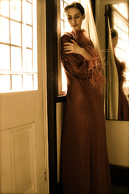 Woman in floor length gown by door - p1072m829530 by Tracy Jean Shields