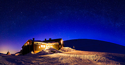 Illuminated house at winter - p312m2092192 by Peter Rutherhagen