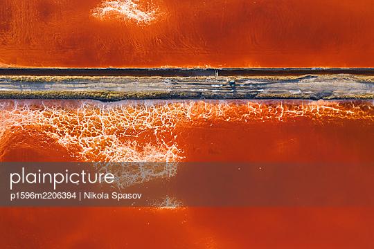 Aerial view of colorful salt lake - p1596m2206394 by Nikola Spasov