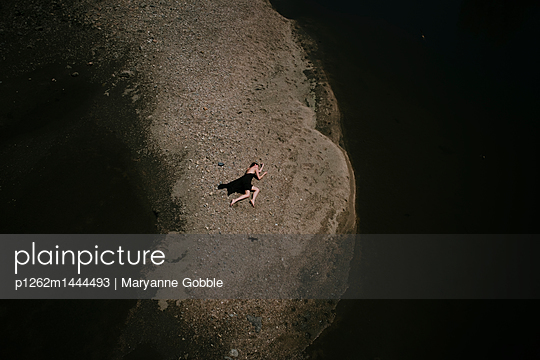 Aerial View of Body Sprawled Out - p1262m1444493 by Maryanne Gobble