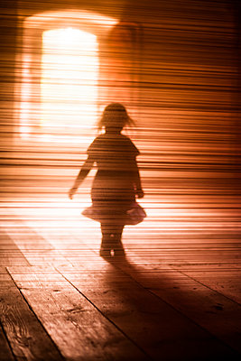 Silhouette of girl walking - p312m1229187 by Peter Rutherhagen