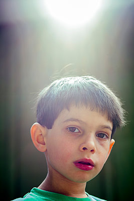 Portrait of serious mixed race boy - p555m1303599 by Adam Hester
