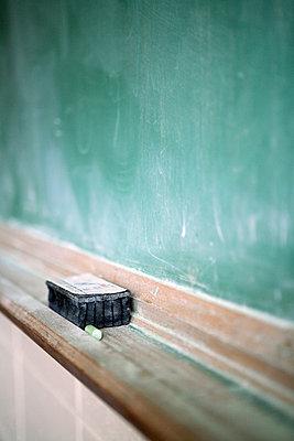 Eraser on chalboard ledge - p3721911 by James Godman