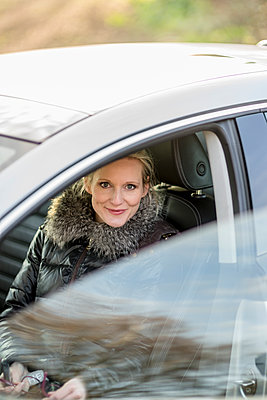 Woman in car - p300m1115097f by Christophe Papke