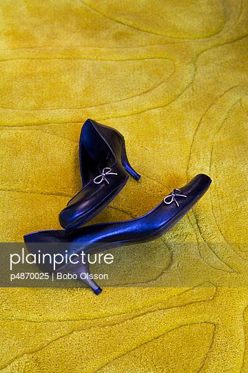 Blue pumps on a yellow carpet - p4870025 by Bobo Olsson