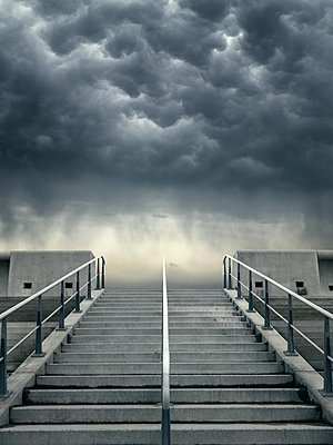 Concrete steps and stormy sky - p1280m2134364 by Dave Wall