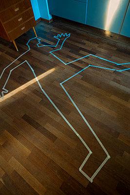 Man cut-out on floor - p1418m2125960 by Jan Håkan Dahlström