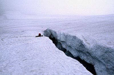 One person in a glacial rift, Sweden. - p5754398f by Anders Modig