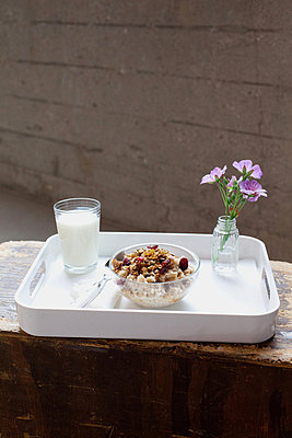 Still life of breakfast tray with bowl of muesli - p92412061 by Steven Lam