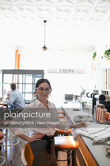 Portrait of restaurant owner looking at camera - p1192m2123319 by Hero Images