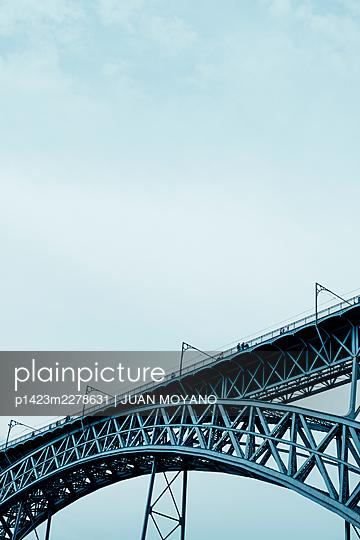 The Dom Luis I Bridge in Porto, Portugal, against the sky - p1423m2278631 by JUAN MOYANO