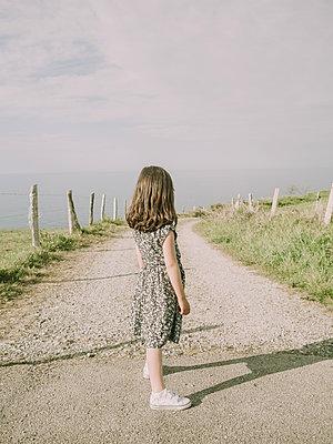 Spain, Asturias, Girl on a gravel road - p1522m2297905 by Almag