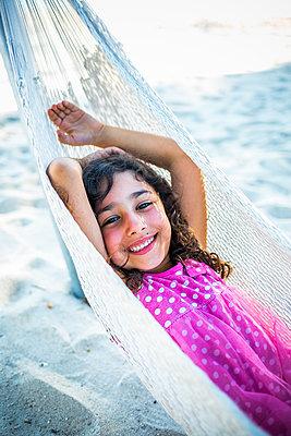 Girl in hammock - p680m1511612 by Stella Mai
