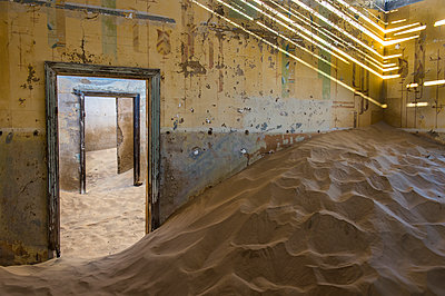 Sand in an old colonial house, old diamond ghost town,  Kolmanskop (Coleman's Hill), near Luderitz, Namibia, Africa - p871m1478783 by Michael Runkel