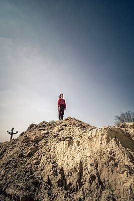 Girl on soil mound - p1402m2260808 by Jerome Paressant