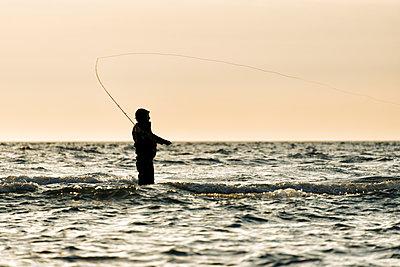 Man fishing at sea, Gotland, Sweden - p575m1074394f by Hans Berggren